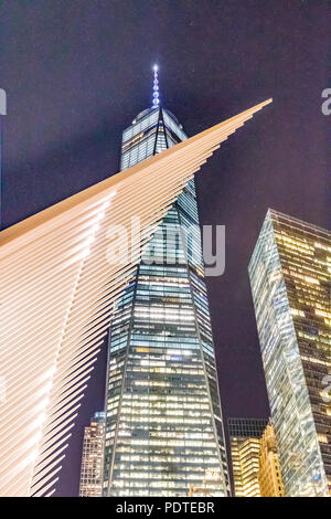 New York - May 31, 2016: World Trade Center Freedom Tower in Lower Manhattan. The Occulus is a Transportation Hub and Westfield Shopping Center, desig - Stock Photo