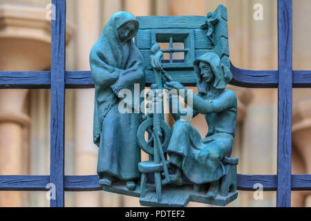 Metal Figures on the fence at the Metropolitan Cathedral of Saints Vitus, Wenceslaus and Adalbert, a gothic Roman Catholic cathedral in Prague - Stock Photo