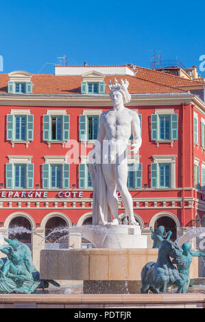 Nice, France - April 19, 2016: Famous fountain du Soleil with the statue of Apollo by Alfred Auguste on Place Massena in Nice on the French Riviera. - Stock Photo