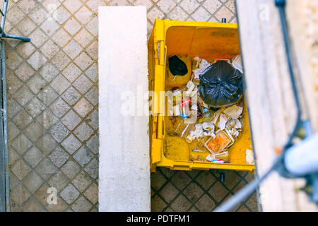 London, UK - August 7, 2018 - Top view of an open rubbish dumpster on street around Southbank - Stock Photo