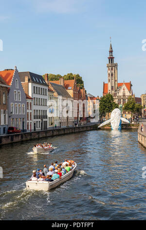 Tourists in a canal tour boat viewing the Bruges Plastic Whale sculpture made from discarded plastic containers and waste washed up from the sea, - Stock Photo