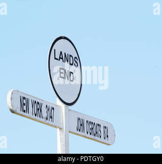 Sign in The Land's End area, Cornwall, England, United Kingdom. Distance signpost at Land's End, Penwith Peninsula, Cornwall, England, most westerly p - Stock Photo