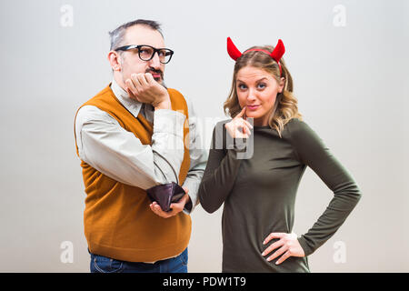 Nerdy man is uncertain,he is thinking does his wife love more him or his money. - Stock Photo