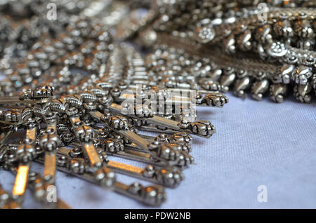 traditional silver and bronze metal fashionable jewellery displayed for sale in mumbai
