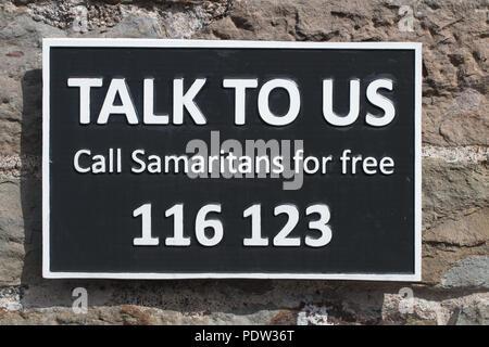 SAMARITANS: Talk To Us - A Sign on Clifton Suspension Bridge - Stock Photo