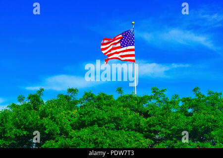 This picture depicts the flag that is flown on liberty island, New York, next to the statue of liberty - Stock Photo