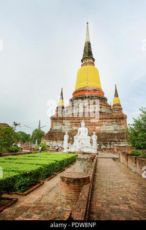 Ancient pagoda and the Buddha image in Wat Yai Chai Mongkhon, Ayutthaya province, Thailand. - Stock Photo