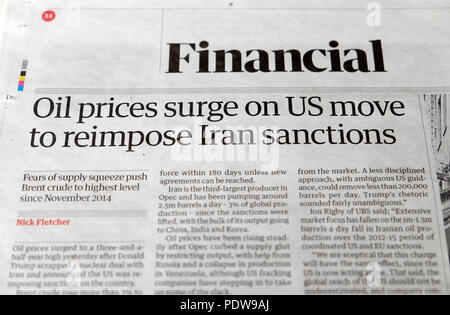 'Oil prices surge on US move to reimpose Iran sanctions'  newspaper headlines in the Financial section of the Guardian paper in London UK - Stock Photo