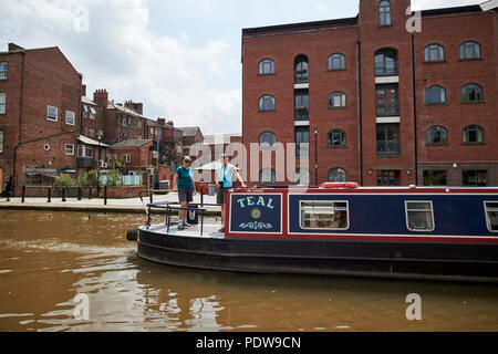 two women on a narrowboat on the Shropshire union canal main line in chester cheshire england uk - Stock Photo
