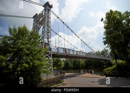 The queens park suspension bridge over the river dee in chester cheshire england uk - Stock Photo