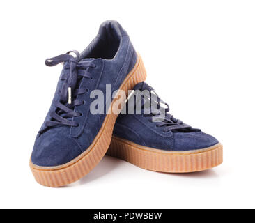 Blue sneakers on high soles in gray and blue isolated on a white background - Stock Photo