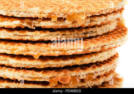 Stack of stroopwafel or caramel filled traditional dutch waffle isolated on a white background - Stock Photo