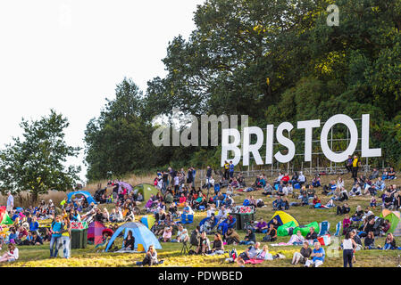 Bristol. Lettering at the Bristol International Balloon Fiesta. Crowd. Audience. People. Mound. Crowds, tents