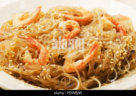 Сellophane noodles or thai vermicelli stir-fried with shrimps and vegetables - Stock Photo