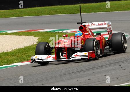 MUGELLO, ITALY 2012: Fernando Alonso of Ferrari F1 team racing at Formula One Teams Test Days at Mugello Circuit in Italy. - Stock Photo