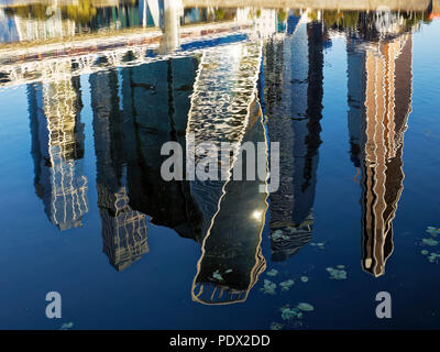 Upside down reflections of high-rise buildings in Moskva River. Moscow International Business Centre (MIBC, or Moscow City), Moscow, Russia. - Stock Photo