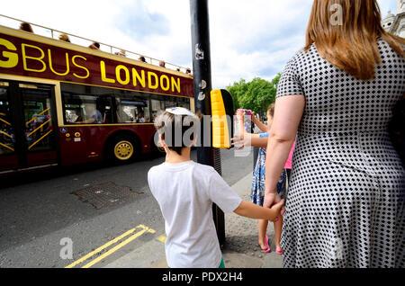 London, England, UK. Young Jewish boy wearing a Kippah / skull cap in central London - Stock Photo