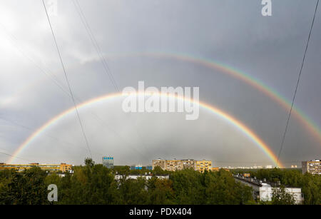 Double rainbow in the sky after summer rain storm on August 7, 2018. Moscow, Russia. - Stock Photo