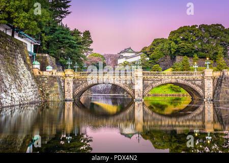 Tokyo, Japan at the Imperial Palace moat and bridge at dawn. - Stock Photo