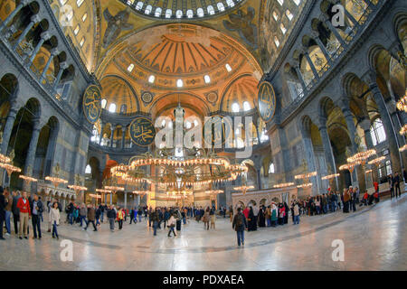 ISTANBUL, TURKEY - MARCH 28, 2012: Tourists in the interior of the Cathedral of St. Sophia. - Stock Photo