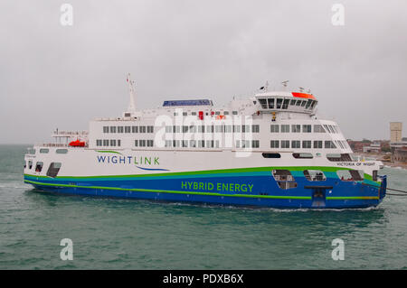 Portsmouth, UK. 10th August, 2018. The new Wightlink Isle of Wight (IOW) car / vehicle ferry MV Victoria of Wight, powered by hybrid energy, has arrived in the UK to be greeted by strong winds and torrential rain. Credit: Neil Watkin / Alamy Live News - Stock Photo