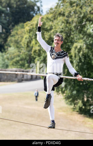 Blenheim Palace, Oxfordshire, UK. 10th August 2018. Christopher Bullzini, a funambulist (tightrope walker), practices ahead of his re-enactment of a walk across the Queen's Pool at Blenheim Palace. The original walk was by Carlos Trower in 1886. Andrew Walmsley/Alamy Live News - Stock Photo