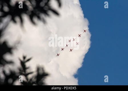 Portsmouth, UK, 10th August 2018, The Red Arrows performing their Cowes Week display over the Solent, Nikki Courtnage Credit: Nikki Court/Alamy Live News - Stock Photo