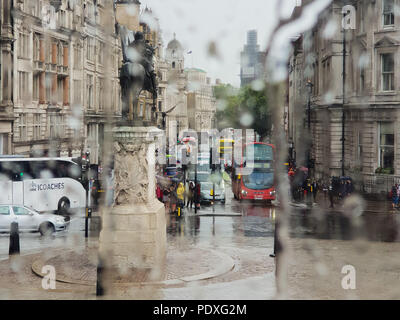 Westminster. London. UK 10 Aug 2018 - View of Whitehall and Big Ben through a double decker bus window covered with raindrops.  Credit Roamwithrakhee /Alamy Live News - Stock Photo