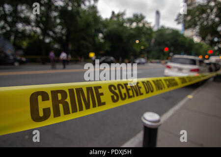New York, USA, 10 Aug 2018.  The scene of a deadly accident involving a garbage truck and a bicycle on Central Park West in Manhattan. A 23 year old woman was struck and killed while riding in the bike lane. The mayor later came to survey the accident which he called, 'disgusting.' Credit: SCOOTERCASTER/Alamy Live News - Stock Photo