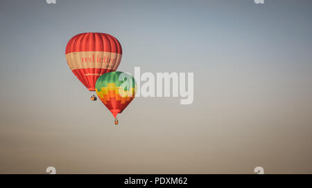 Bristol, UK. 11th August, 2018. Colourful balloons at the 40th anniversary of the international balloon fiesta. Balloons fill the skies around Clifton Suspension Bridge and surrounding areas. Andrew Coleman/Alamy Live News - Stock Photo