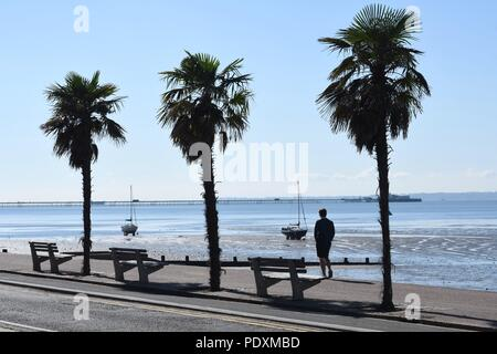 Southend-on-Sea, Essex, UK. 11th August, 2018. UK Weather: A warm start to the day in Southend - a view of a Man walking along the sea front Credit: Ben Rector/Alamy Live News - Stock Photo