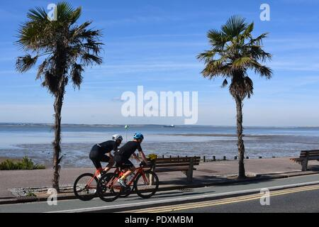 Southend-on-Sea, Essex, UK. 11th August, 2018. UK Weather: A warm start to the day in Southend - a view of people cycling along the sea front Credit: Ben Rector/Alamy Live News - Stock Photo