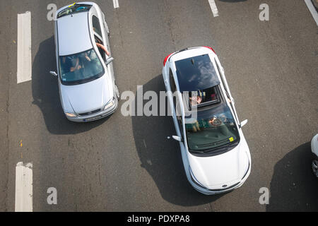 Zargreb, Croatia, August 11th, 2018 : Happy woman waving to the camera during traffic jam due to the large number of tourists going to the sea coast of Croatia in the Lucko highway toll in Zagreb. Credit: Goran Jakuš/Alamy Live News - Stock Photo