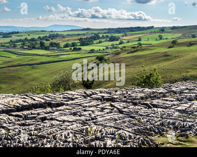 View from Malham Cove with Pendle Hill on the horizon near Malham Yorkshire Dales England - Stock Photo
