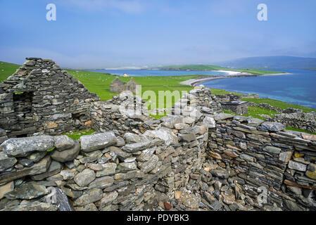 Ruins of abandoned farm buildings / croft house on the Kettla Ness peninsula on West Burra, Mainland, Shetland Islands, Scotland, UK - Stock Photo