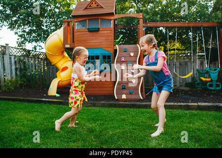 Children (6-9) play fighting on playground Stock Photo ...