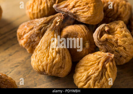 Raw Brown Dried Figs Ready to Eat - Stock Photo
