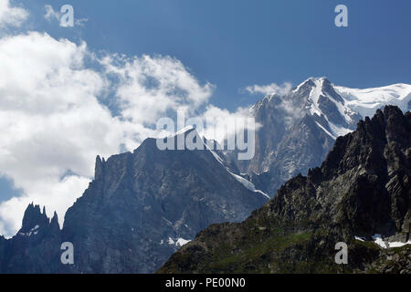 Mont Blanc (Monte Bianco) and the Aiguille blanche de Peuterey in Aosta Valley, Alpes of Italy, in a summer morning. - Stock Photo