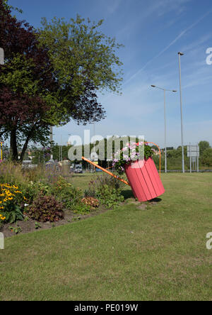 Bury in bloom flower display, watering can with flowers on traffic roundabout in bury lancashire uk - Stock Photo