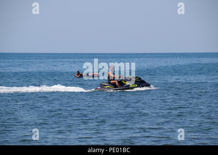 Novorossiysk, Russia - August 06, 2018: A man is riding a hydrocycle. Sea beach of the Broad Beam near the city of Novorossiysk. - Stock Photo