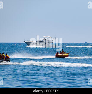 Novorossiysk, Russia - August 06, 2018: Motor transport in the sea, cutter, hydrosculator and boat. - Stock Photo