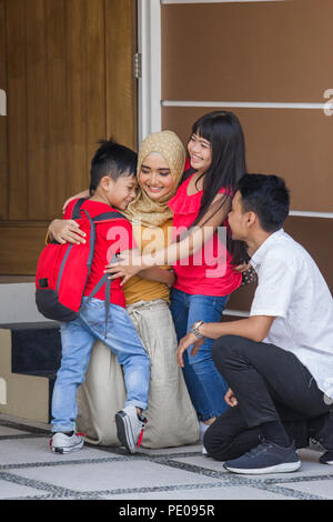 asian kid boy and girl hug their parents before going school - Stock Photo