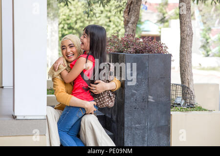 Happy family daughter running and hugging mum after going back from school - Stock Photo