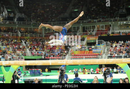 Olympic champion Simone Biles of United States competing on the balance beam at women's all-around gymnastics at Rio 2016 - Stock Photo