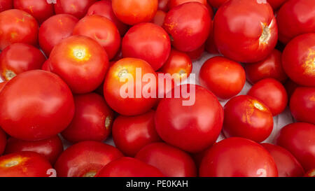 Close Up of Red Large Tomatos for Sale - Stock Photo