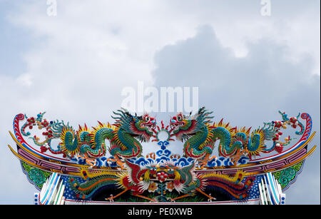 Golden dragon statue. Chinese dragon on the temple roof. - Stock Photo