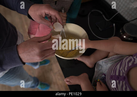 Father with his kids preparing food in kitchen - Stock Photo