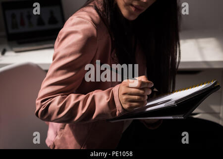 Fashion designer making sketch in the design studio - Stock Photo