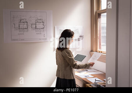 Business woman using digital tablet - Stock Photo