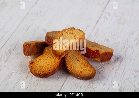 Sweet tasty rusk over wooden - Stock Photo